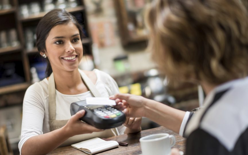 payment-trends-a-customer-paying-with-a-card-on-a-payment-device