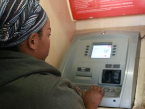 a-lady-drawing-money-at-an-atm-machine
