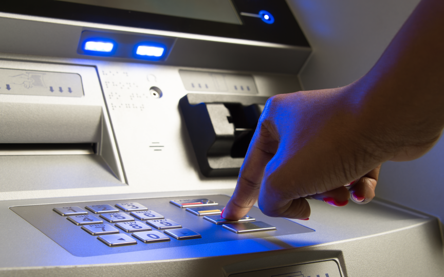 atm-machine-with-a-person-pressing-a-button
